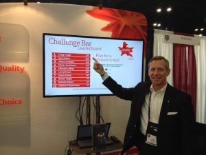 Top scoring trade show trivia game player points to his name on the leaderboard