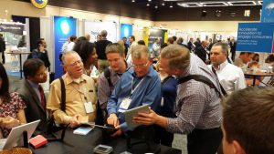 trade show trivia game with highly engaged attendees conferring